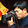 大连晚报首席摄影记者-李传报