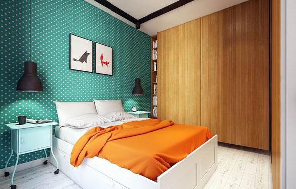 绿色墙面与桔色床品的碰撞
