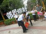 杭州保安光膀子冲入火场 业主自发募捐爱心款褒奖英雄