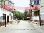 小区挂条幅欢迎瓜农来卖瓜 物业端来红烧肉(图)