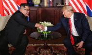 Int'l community hails Kim-Trump landmark summit