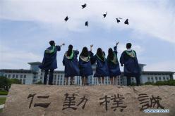 Graduating students pose for photos at Nanjing Agricultural University